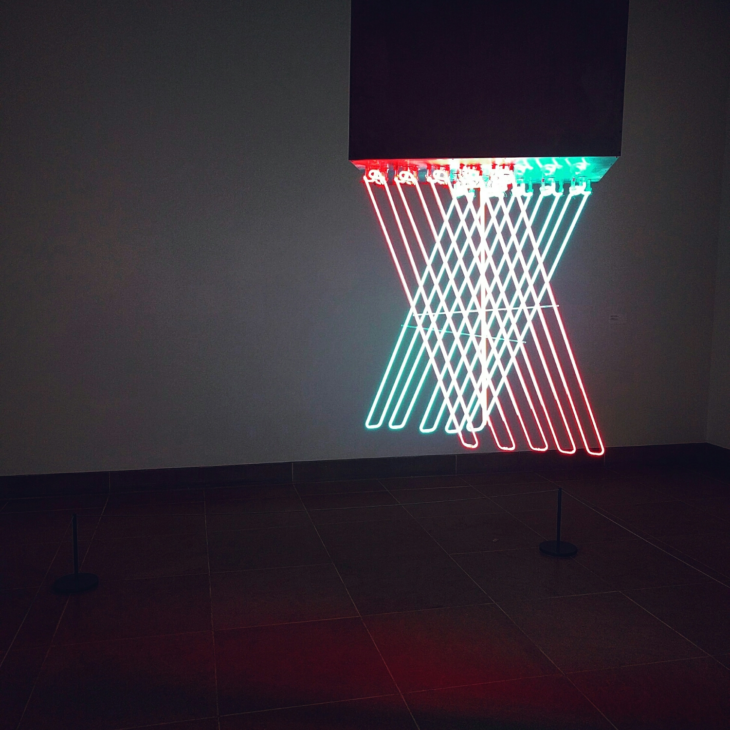 'Hanging Neon'.  Stephen Antonakos. n  eon & black paint on metal   .
