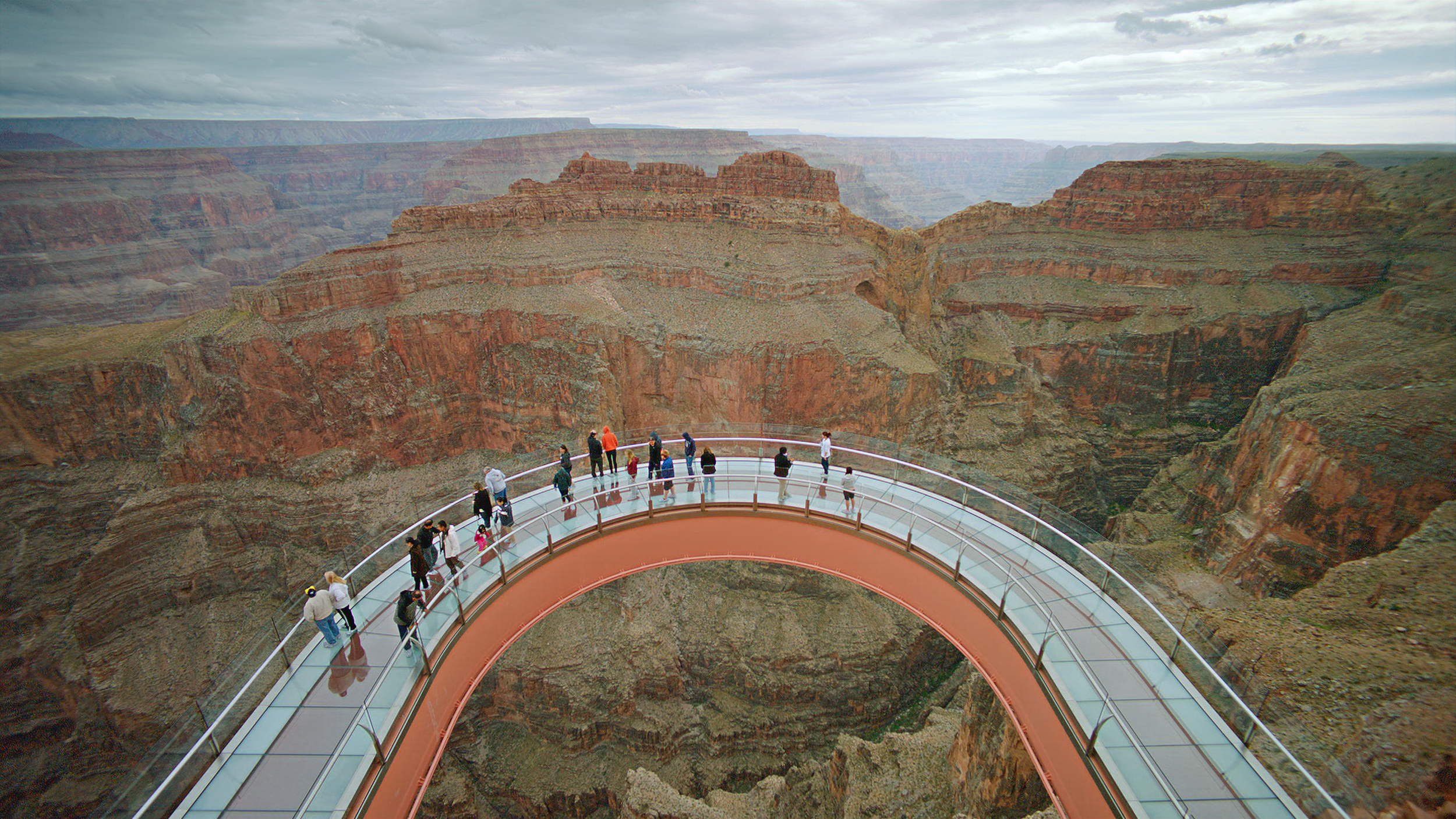 Grand Canyon Skywalk suspends people high above canyon floor.
