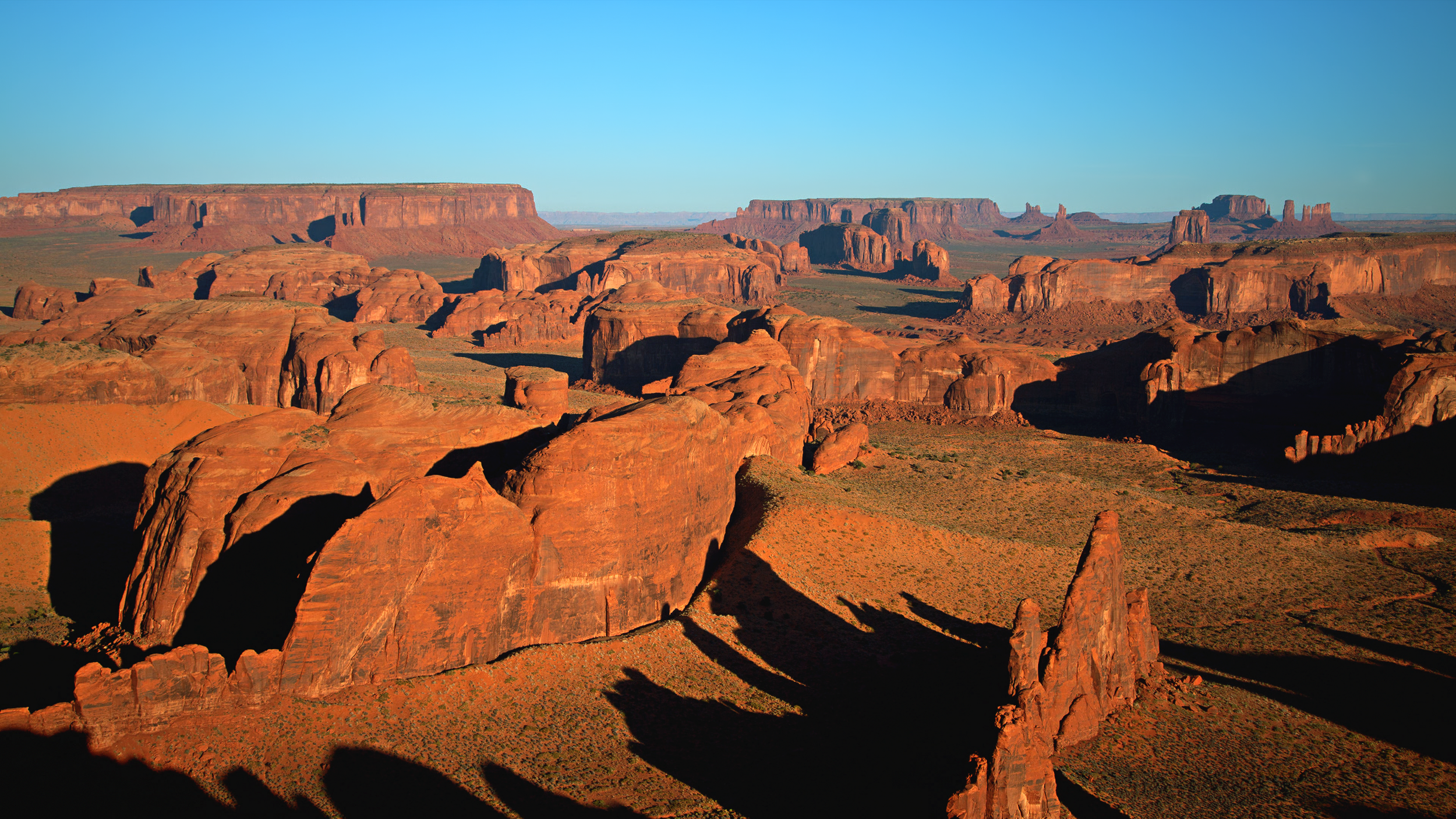 View of Monument Valley from atop Hunts Mesa, Utah.