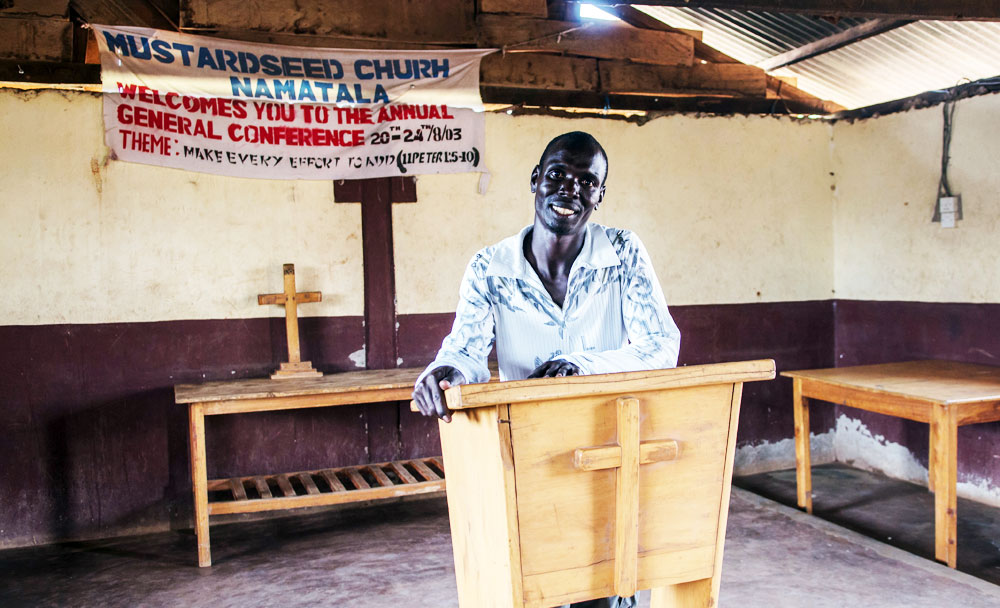 Phillip, Peace's husband, at their Church, The Mustard Seed.