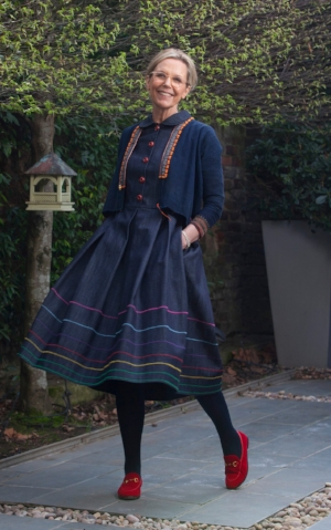 Jet teams her Eponine denim dress with a vintage Hmong jacket and Gucci loafers