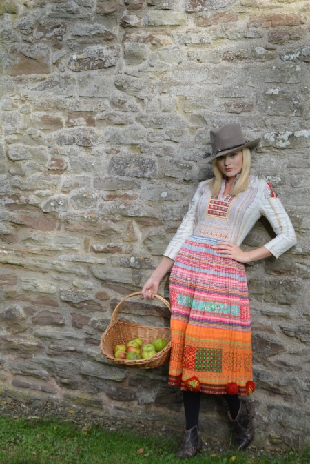 Laura's model wearing a hat from her Prairie Collection and an Eponine dress from our Hmong collection.