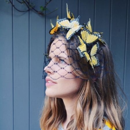 Laura's model wearing a hat from her Butterfly House Collection and an Eponine Yellow and Grey Zig Zag Round Neck