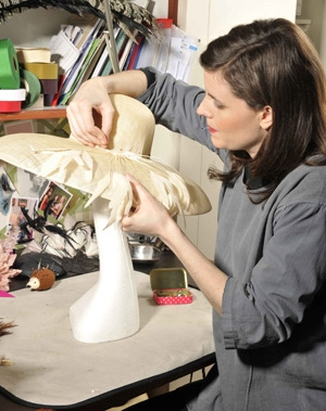 Laura working on a hat from her Millinery Garden Collection