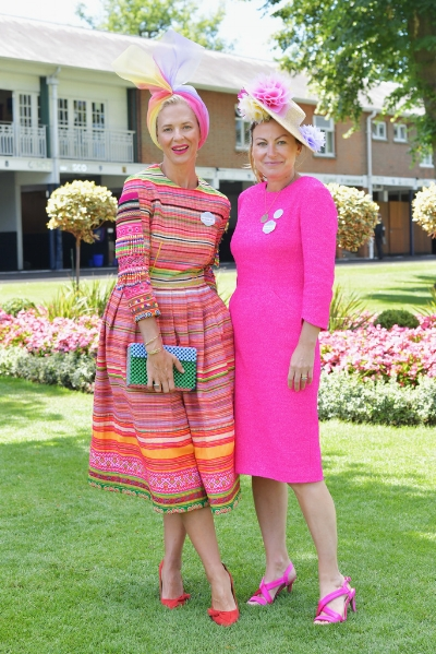 Deborah (left) wears a Hmong dress, and Kara (right) wears an SS17 couture dress