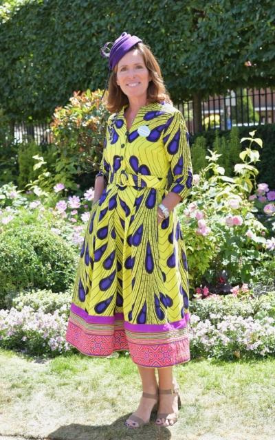 Sian wears a ready-to-wear African cotton shirtwaister dress with a Hmong trim