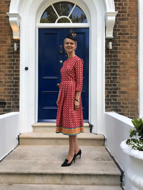 Helen wears a ready-to-wear African cotton dress with Hmong trim