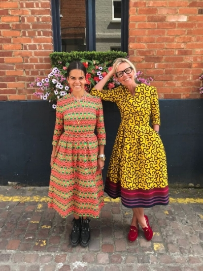Jet and Nina wearing dresses from the new collection