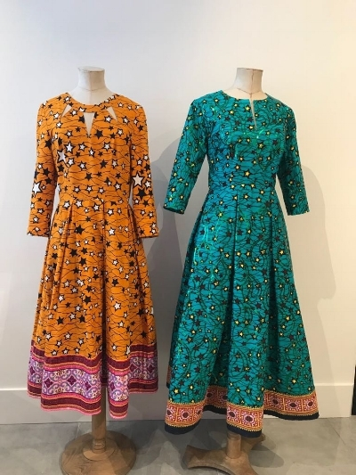 Two bespoke African cotton dresses with Hmong trims