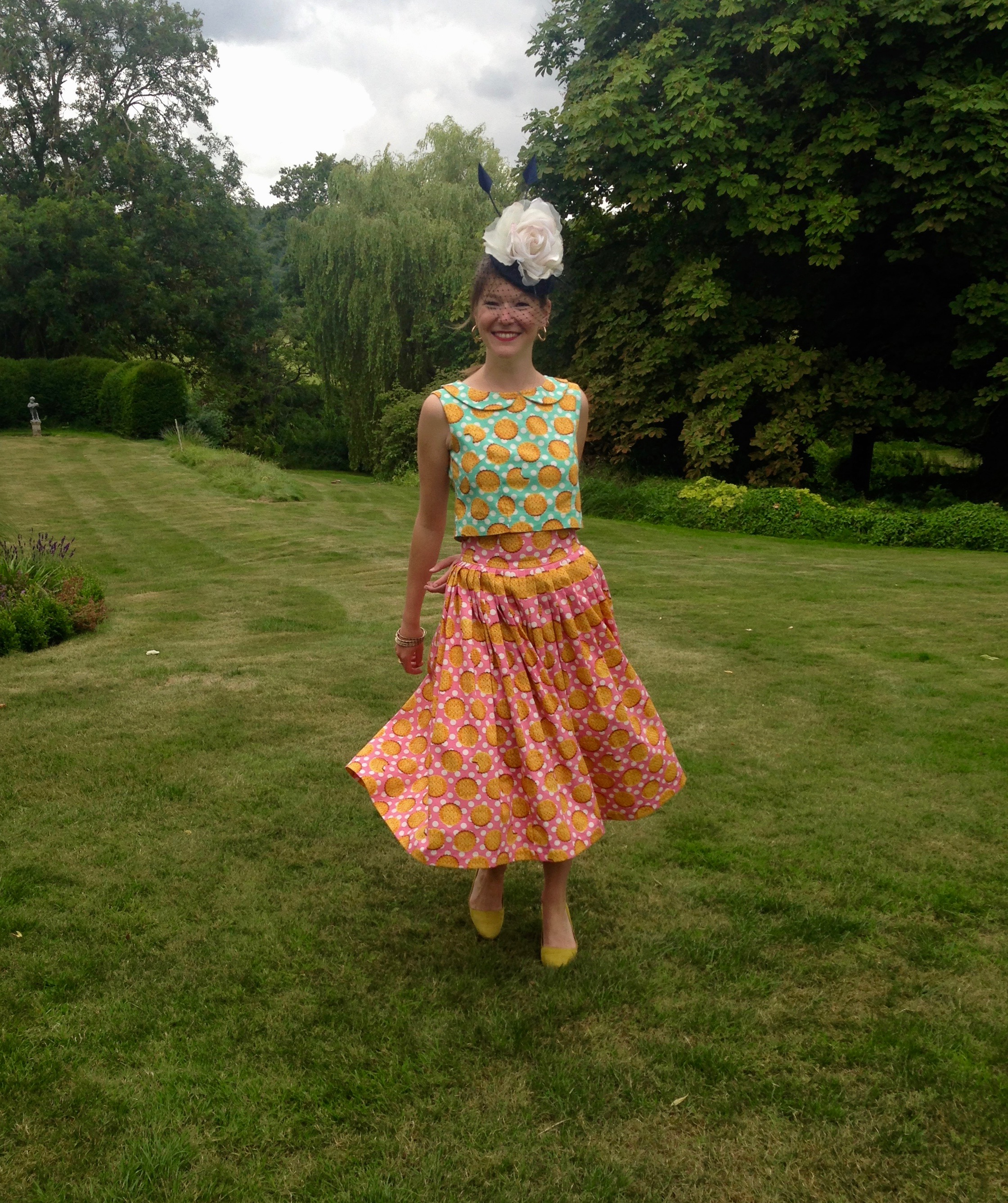 Rosemary wearing her biscuit cropped top and high waisted skirt