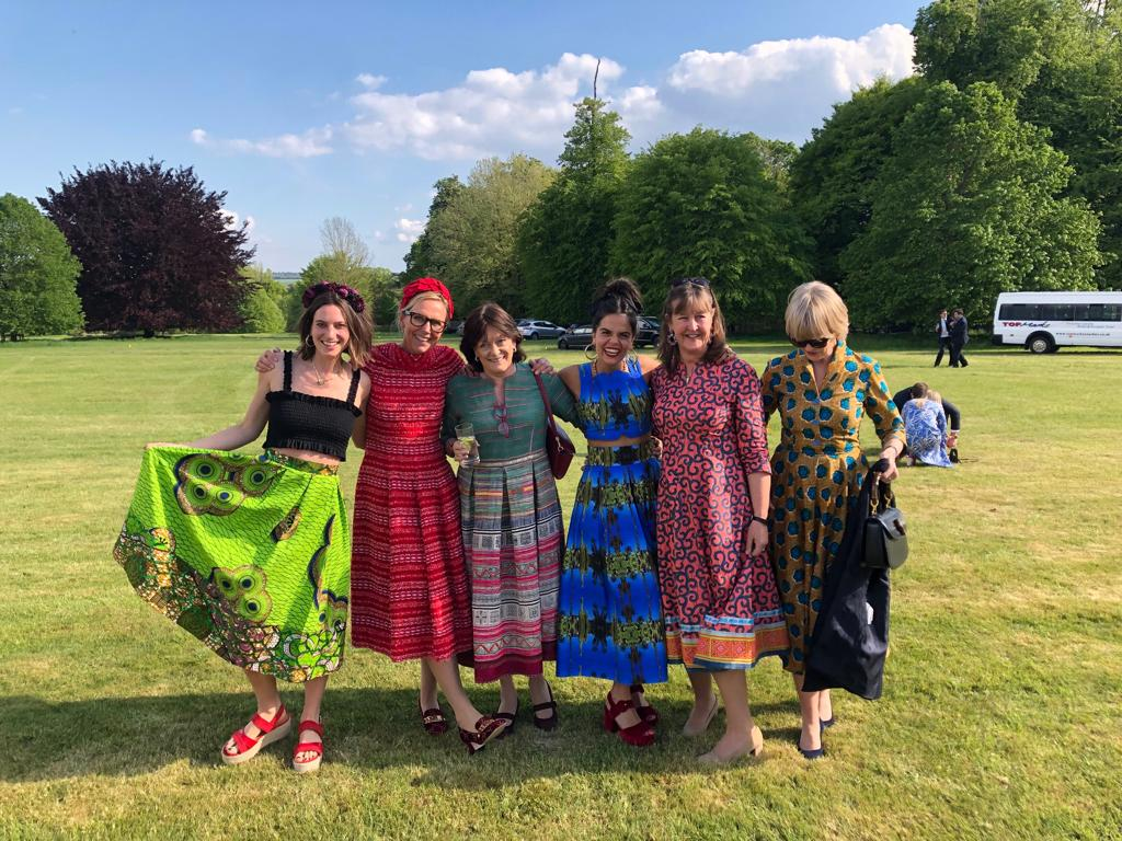 (Left to right)  Milly wearing a ready-to-wear African cotton skirt from a previous collection; Jet wearing the Lisa Carol Fremont dress from the current Summer '19 collection; Lucinda wearing a bespoke Hmong dress; Nina wearing a bespoke two-piece using the Pam Weinstock x Eponine Majorelle Garden print; Libby wearing a bespoke African cotton dress with a Hmong trim; Annie wearing a ready-to-wear African cotton dress from a previous collection.
