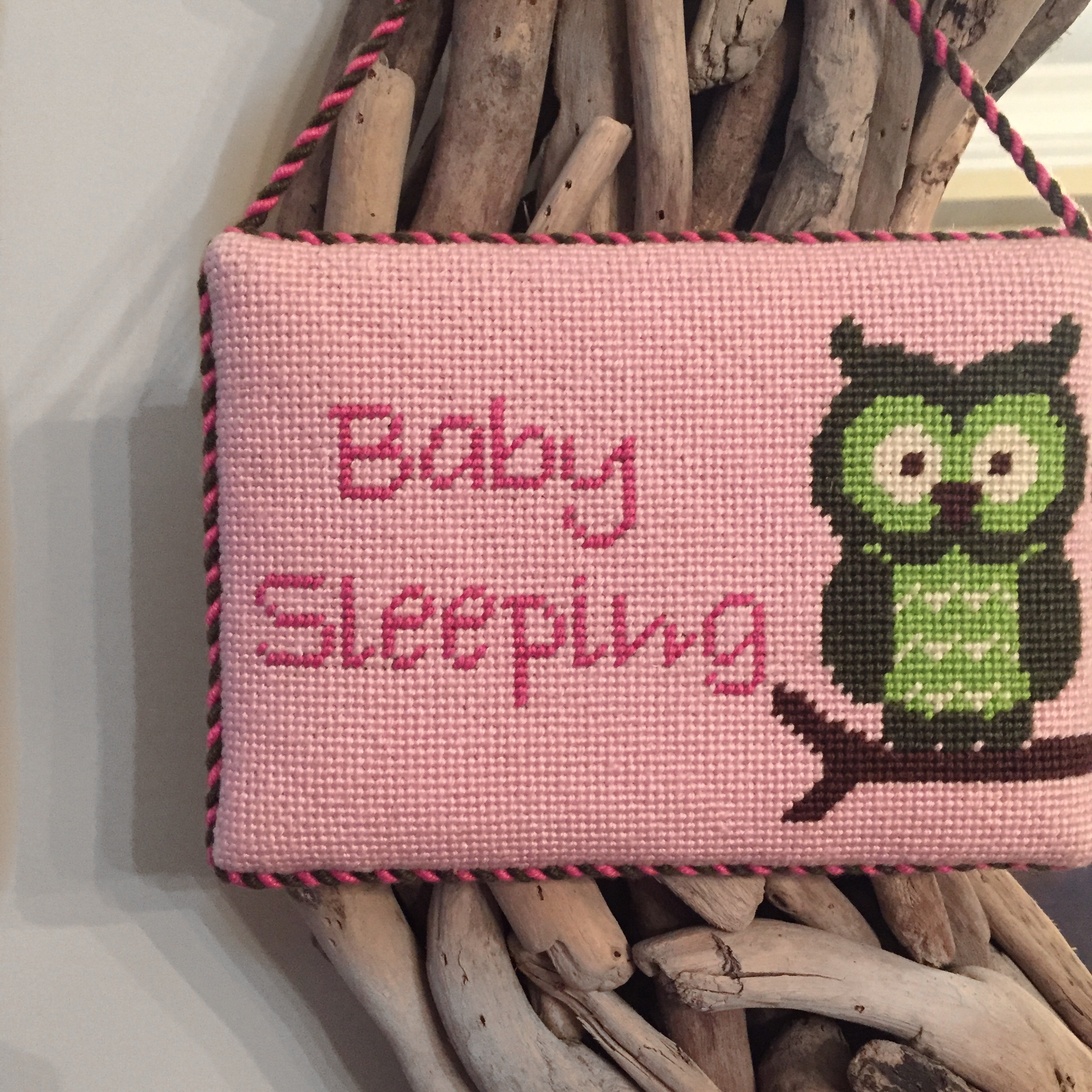 A recently finished hand-needlepointed sign for our niece's nursery