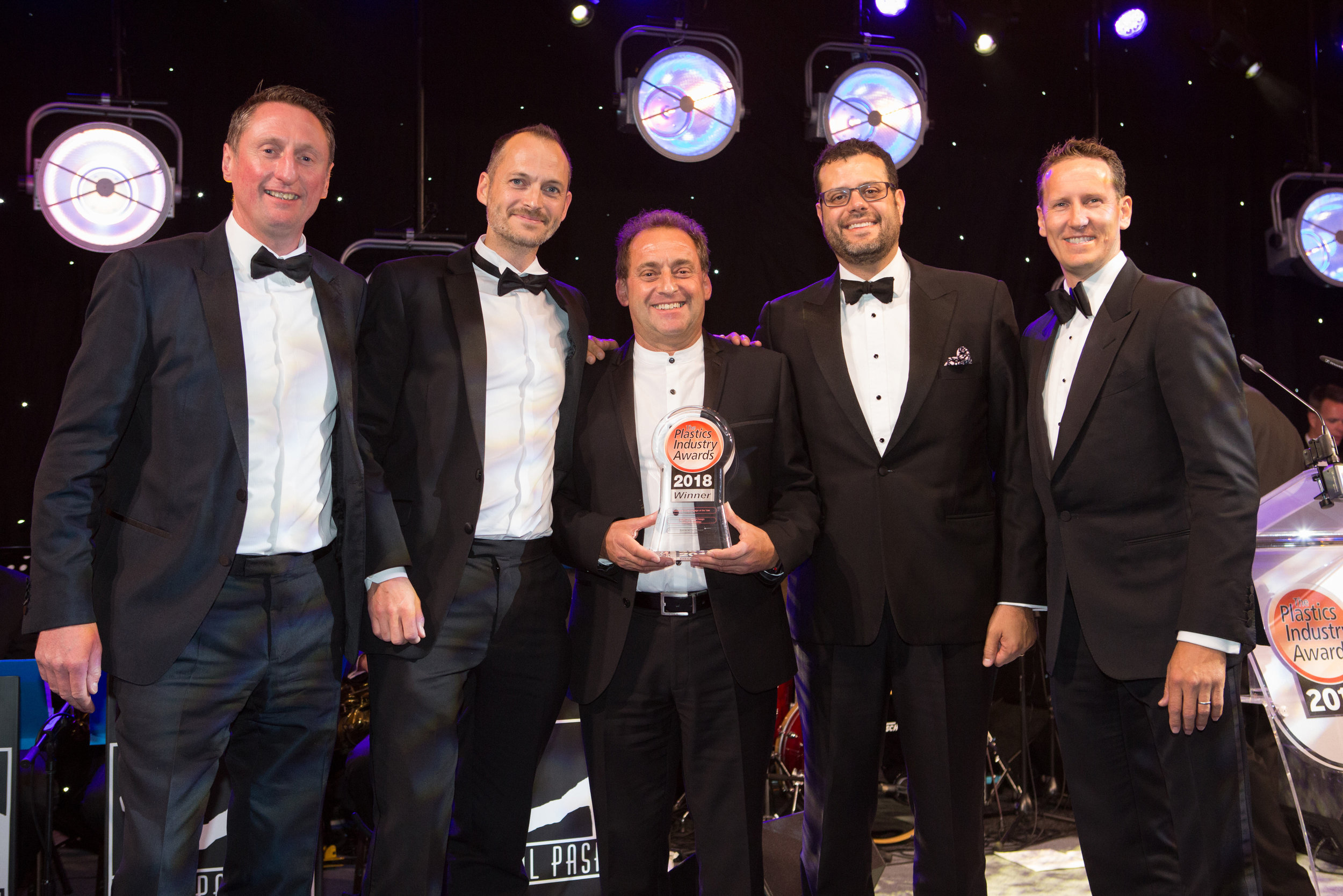 Smallfry CEO, Steve May-Russell With Dave Spurling and John E.Milad from Quanta Dialysis Technology receiving the Plastic Industry Award from ex Strictly Professional Dancer Brendan Cole