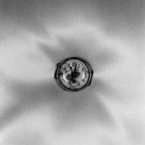 Shomei Tomatsu.A wristwatch dug up approximately 0.7 km from the epicenter of the blast. The watch indicates 11:02, the time of the explosion. Nagasaki, 1961.