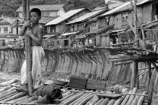 Shigeichi Nagano. Boy in front of his fishing village. Shimane peninsula, 1953.