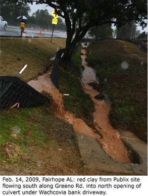 Runoff filled with sediment rushes over insufficient silt fences at a problem site in Fairhope, Al