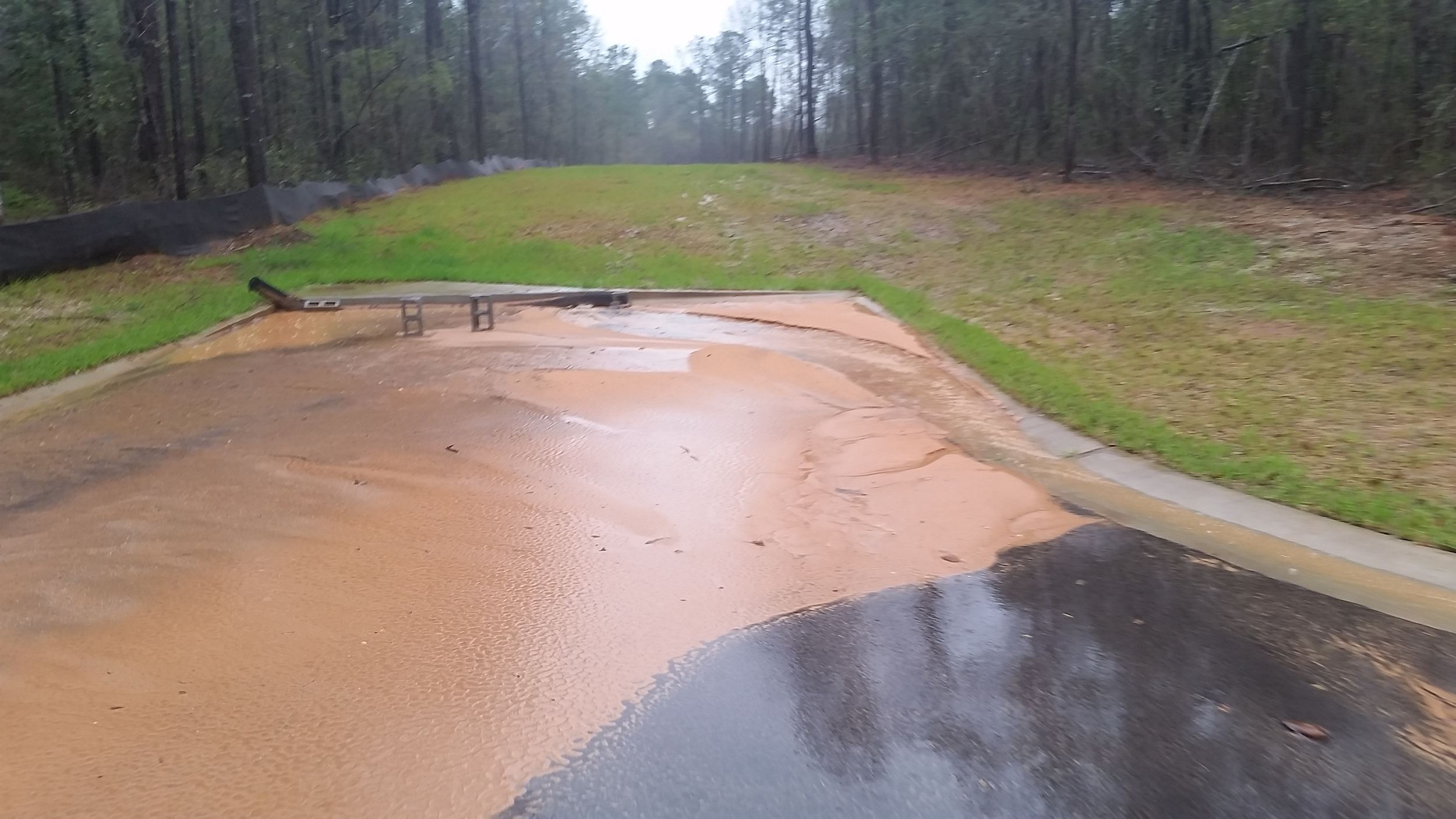 Sediment from a construction site in Baldwin County is washed into a storm drain.