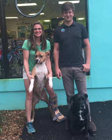 It's a family affair at Pro Cycle & Tri. Katie and Joseph pose with their loyal companions Frank and Chip in front of the shop after our interview.