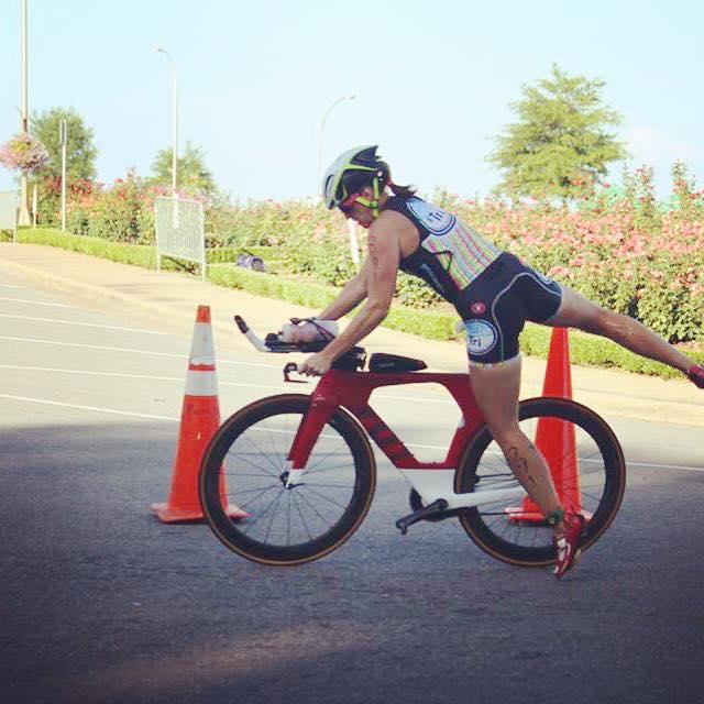 Katie mounts her bike in transition.