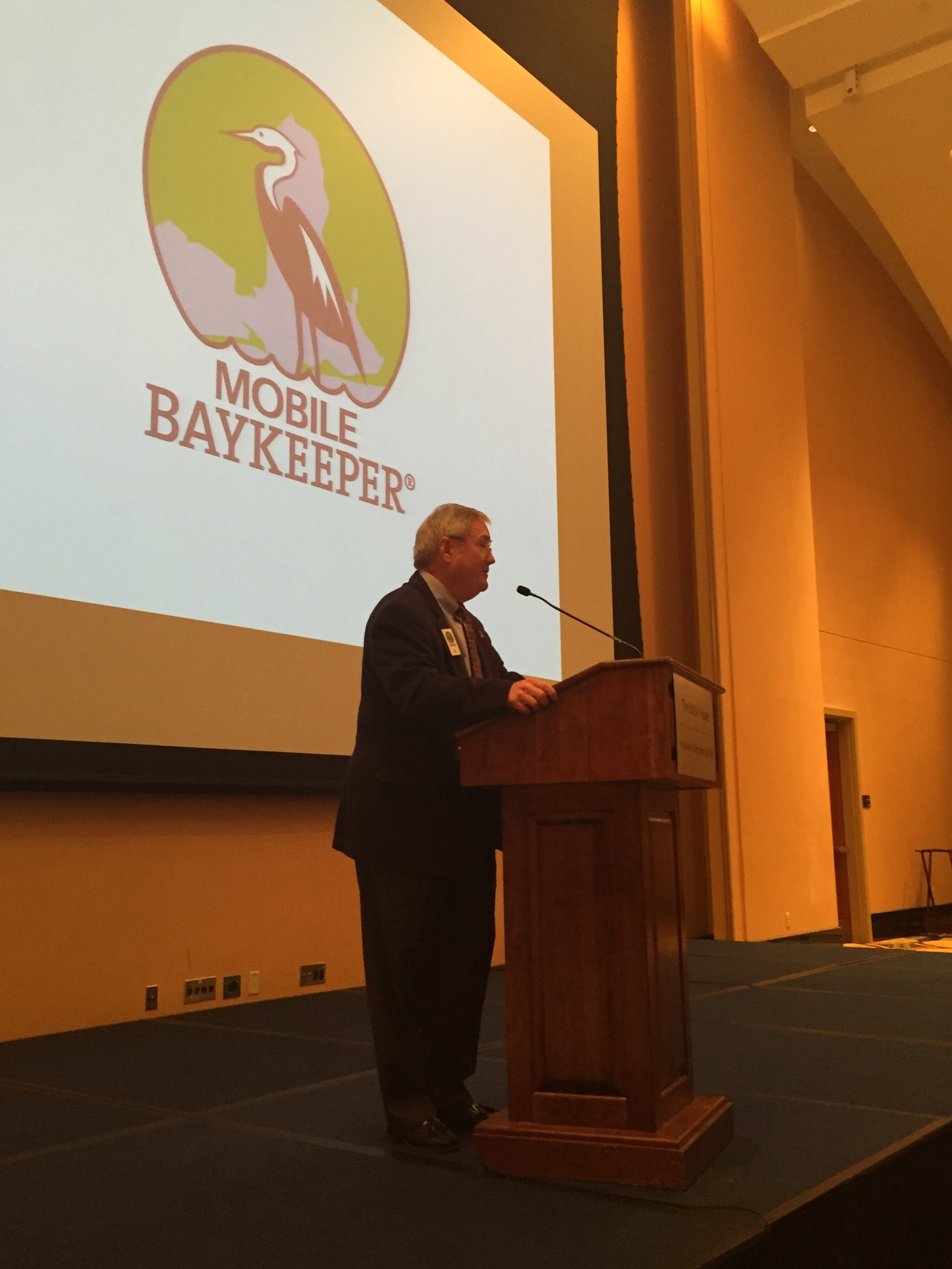 Board Member and Past President Ray Mayhall encourages guests to become more engaged with Mobile Baykeeper.