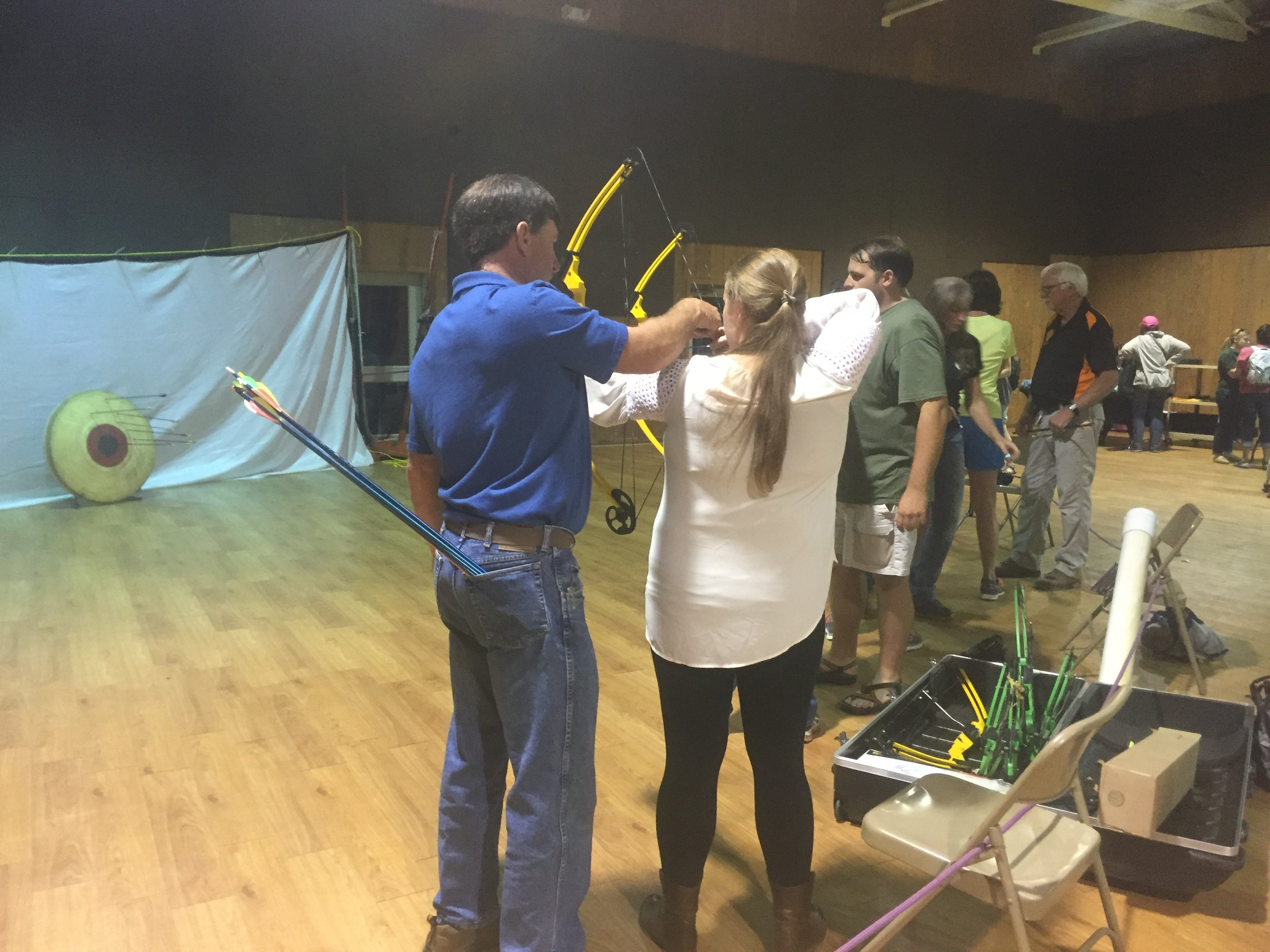 """Winner winner, chicken dinner!"" After our delicious fried chicken supper, Mike Guilotte guided me RIGHT to the bullseye during archery practice on Friday evening!"