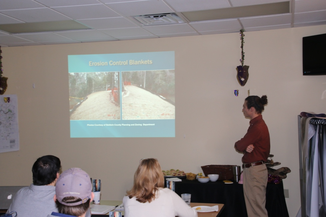 Muddy Water Watch workshop participants learn about stormwater controls.