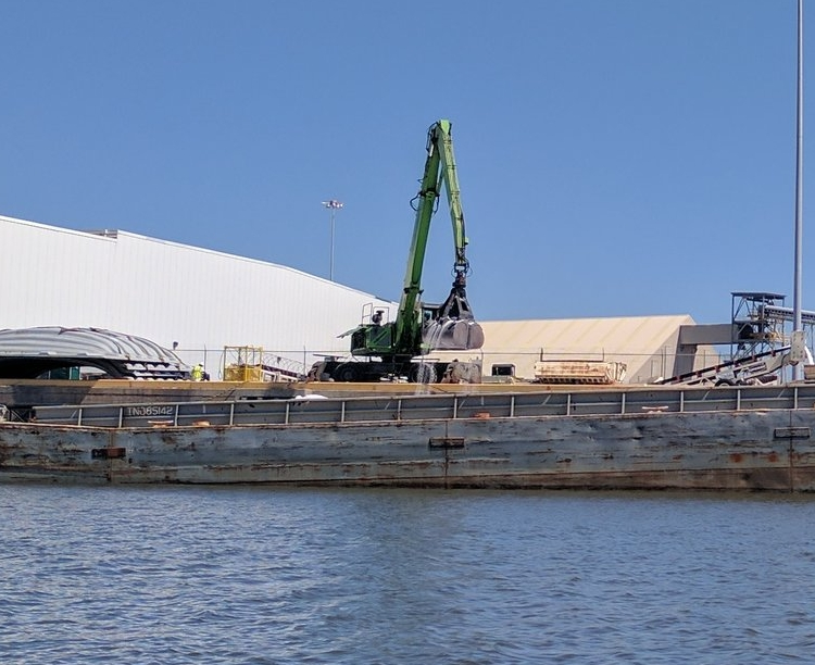 Millard Maritime unloads fertilizer at their facility on Theodore Industrial Canal.