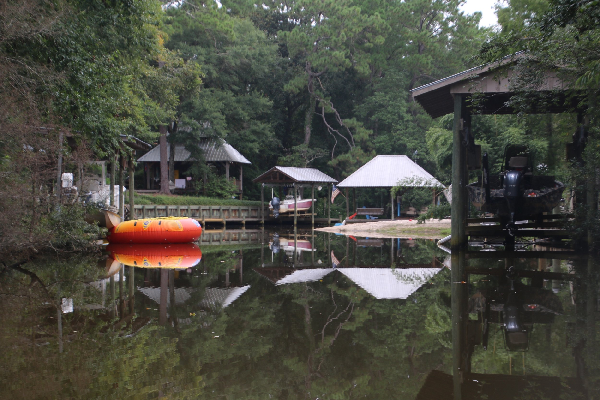 Boathouses where families typically enjoy swimming, and playing in Fly Creek.