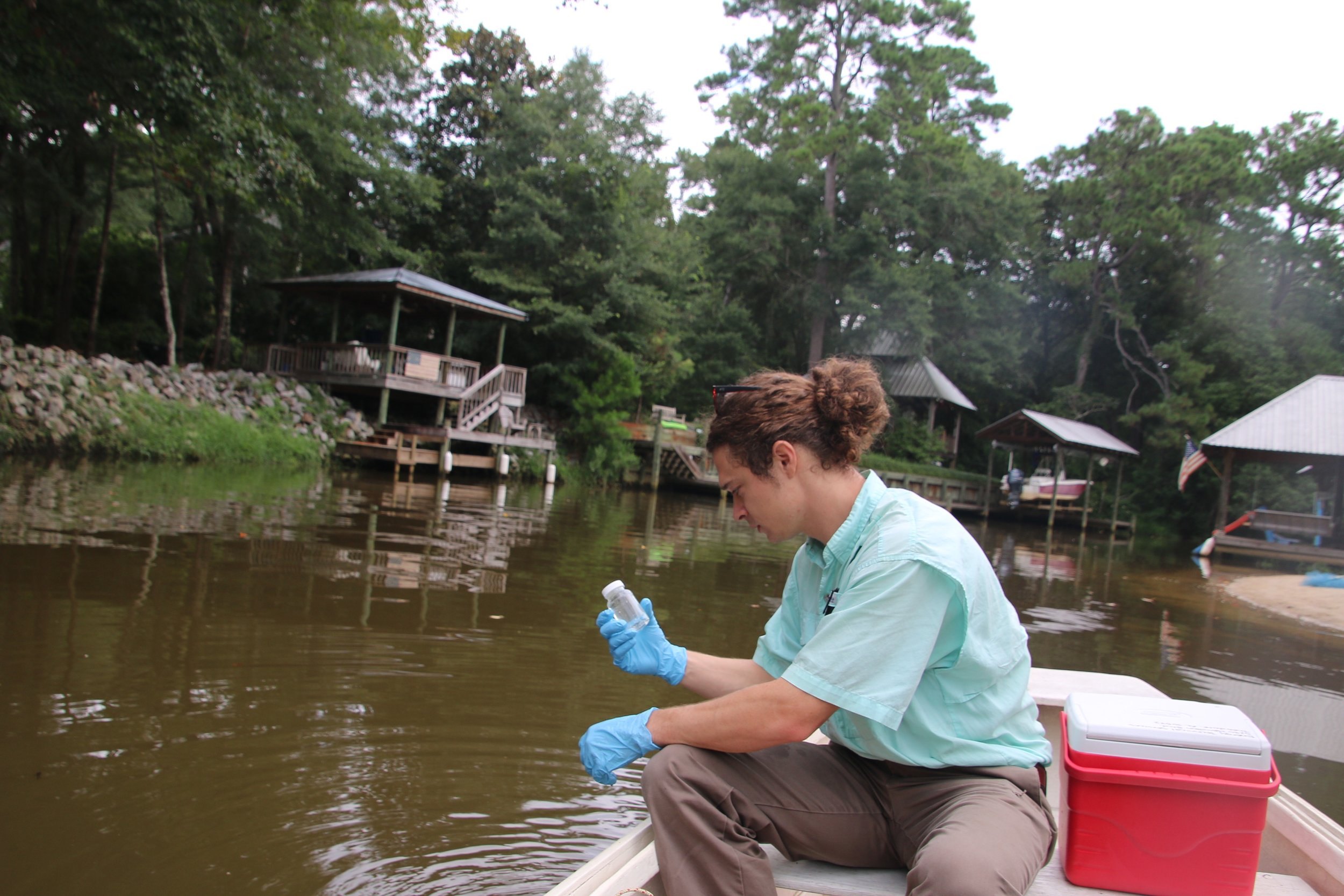 Mobile Baykeeper program director, Cade Kistler, tests for bacteria on Fly Creek.