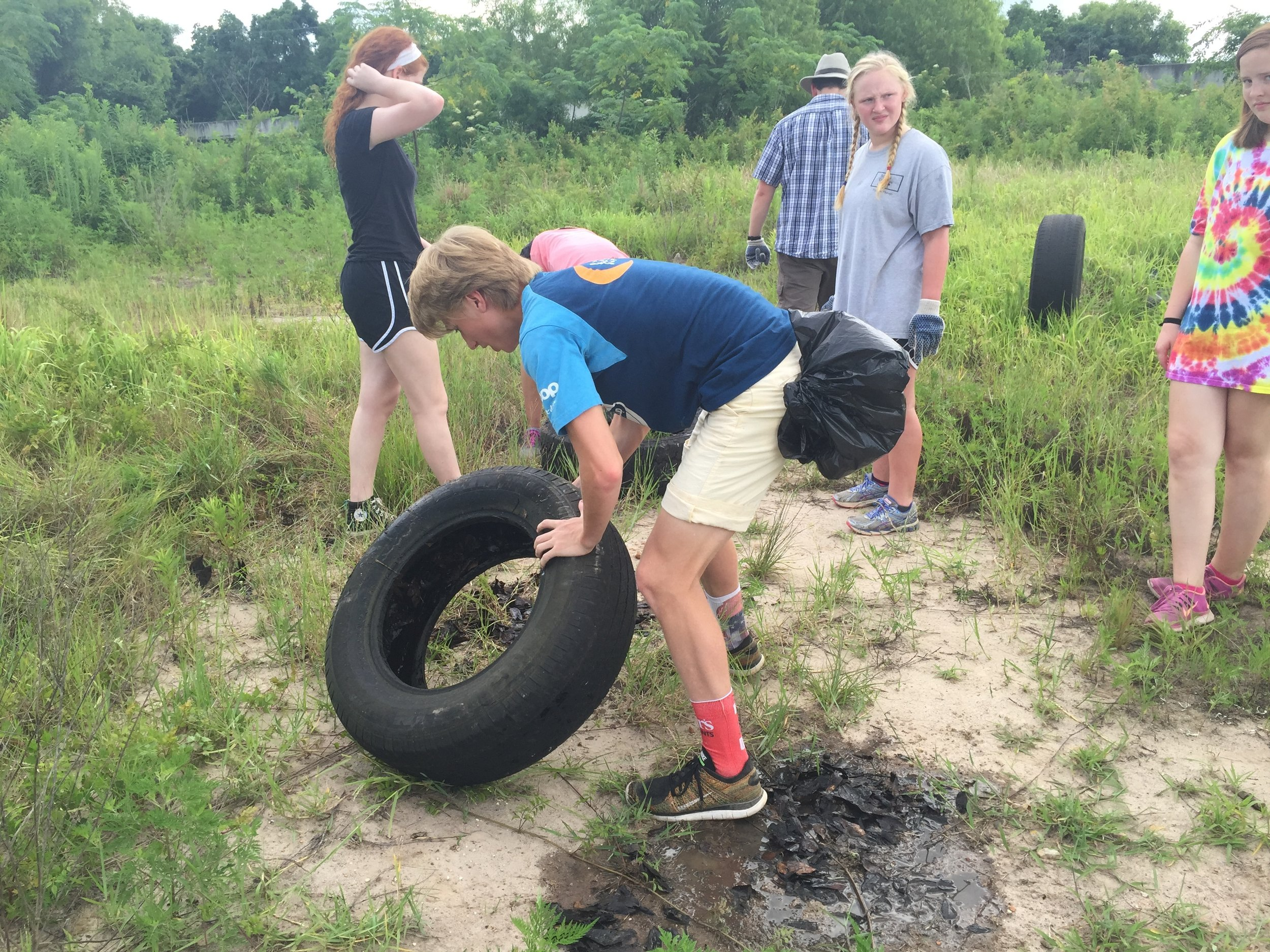 Visiting students with the Urban Mission Camp find numerous tires and other debris each summer near One Mile Creek during litter cleanups with Mobile Baykeeper.