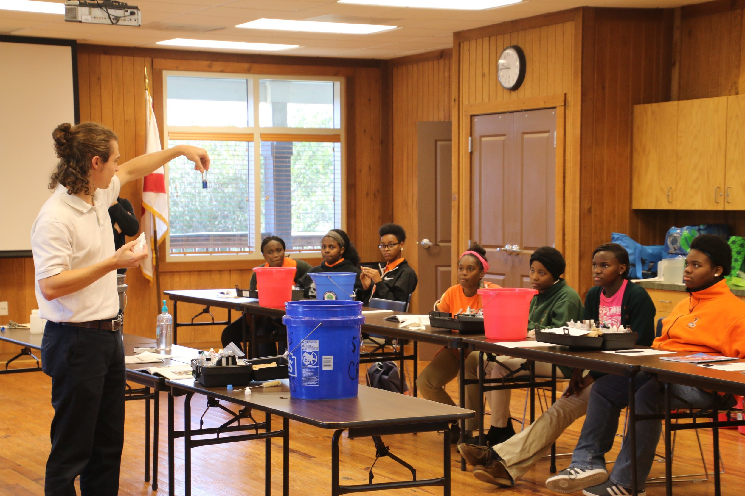 Program Director Cade Kistler trains students from LeFlore High School to become certified water quality monitors.