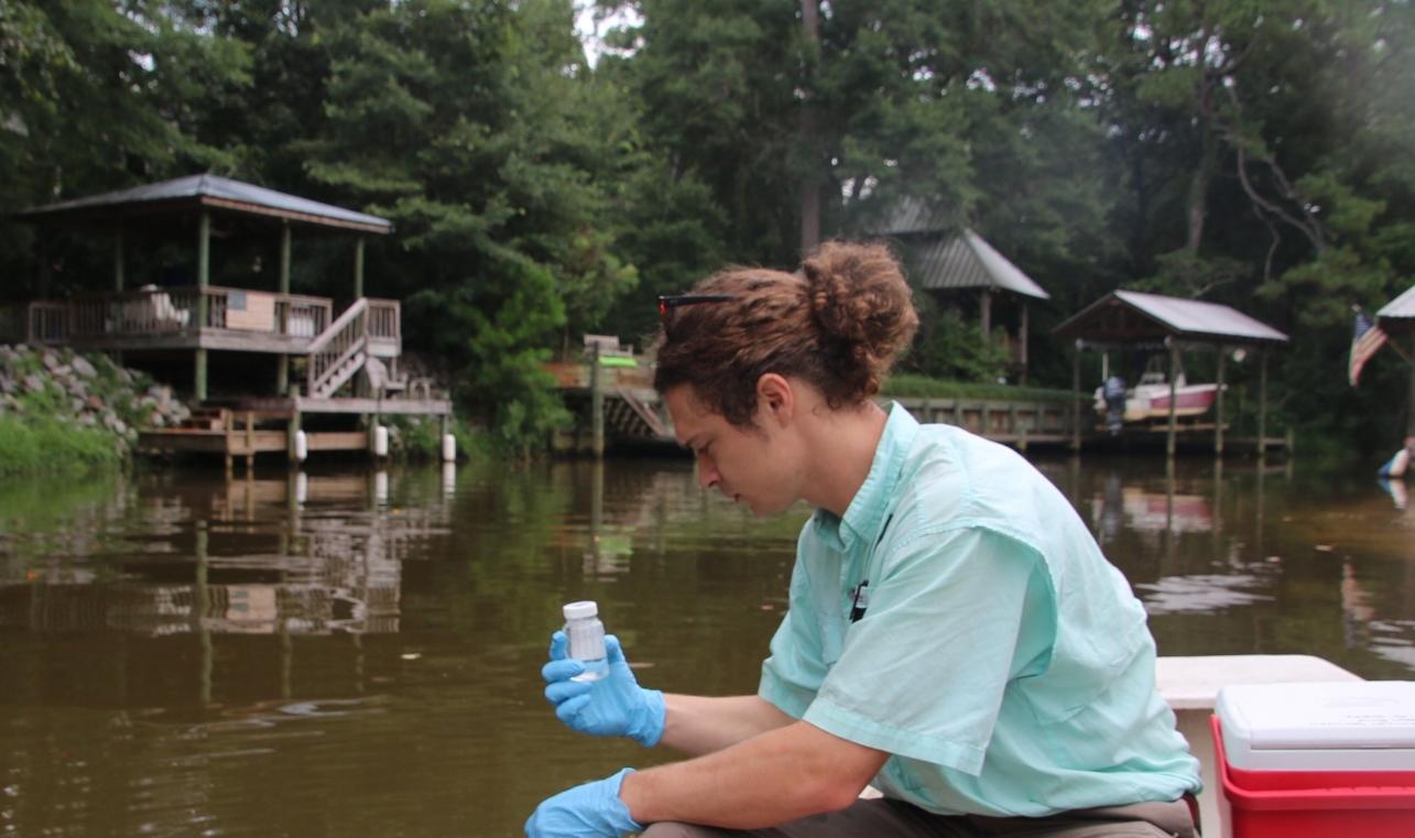 Program Director, Cade Kistler, tests for bacteria in Fly Creek.