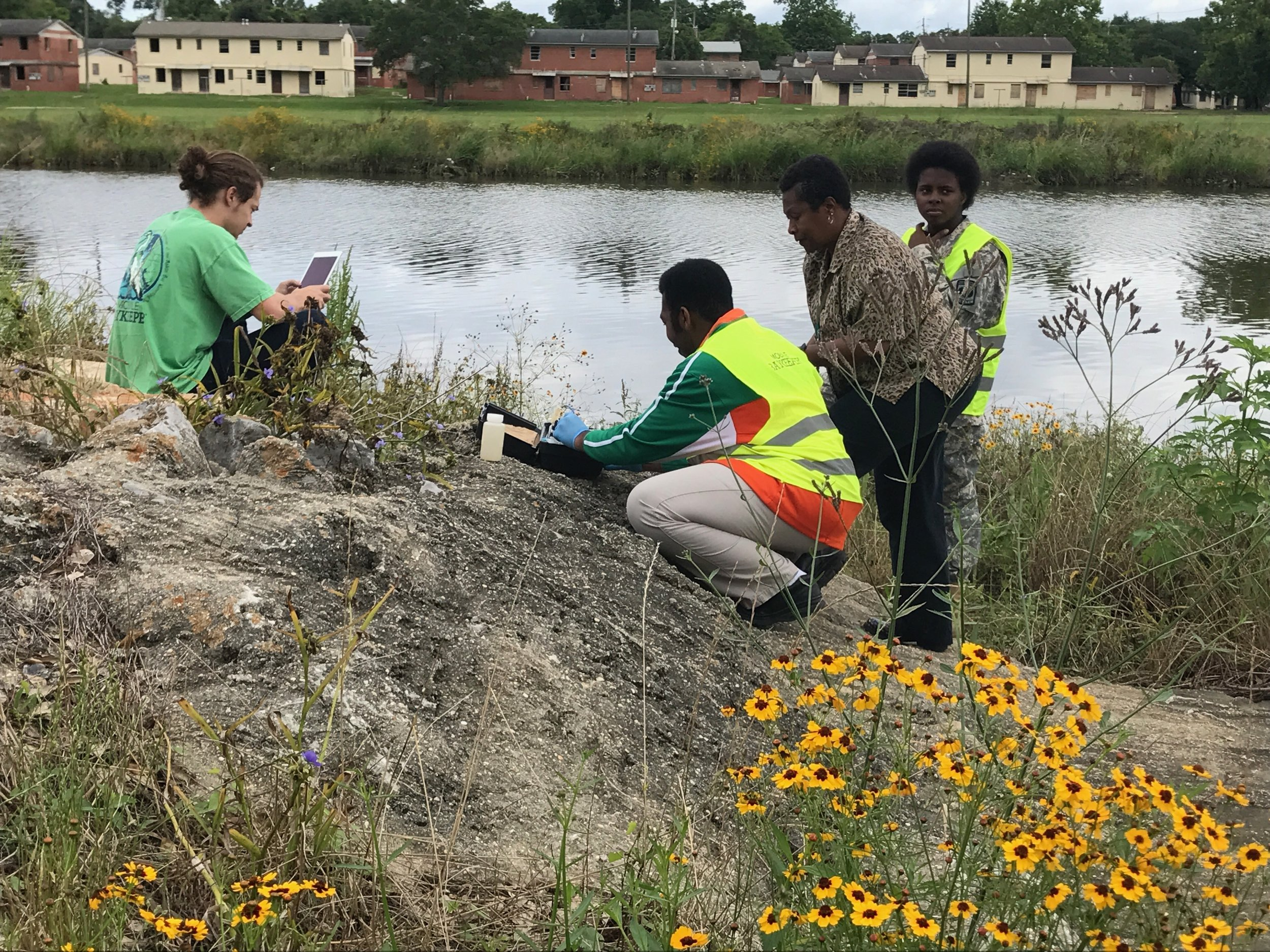 Students from LeFlore High School test the water quality along Three Mile Creek with guidance from Program Director Cade Kistler.