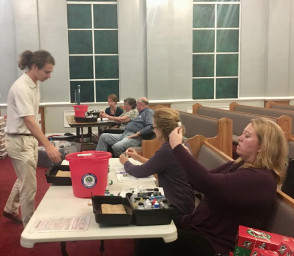 Program Director Cade Kistler trains adults at Hollinger's Island Baptist Church to be certified water quality monitors through Alabama Water Watch.