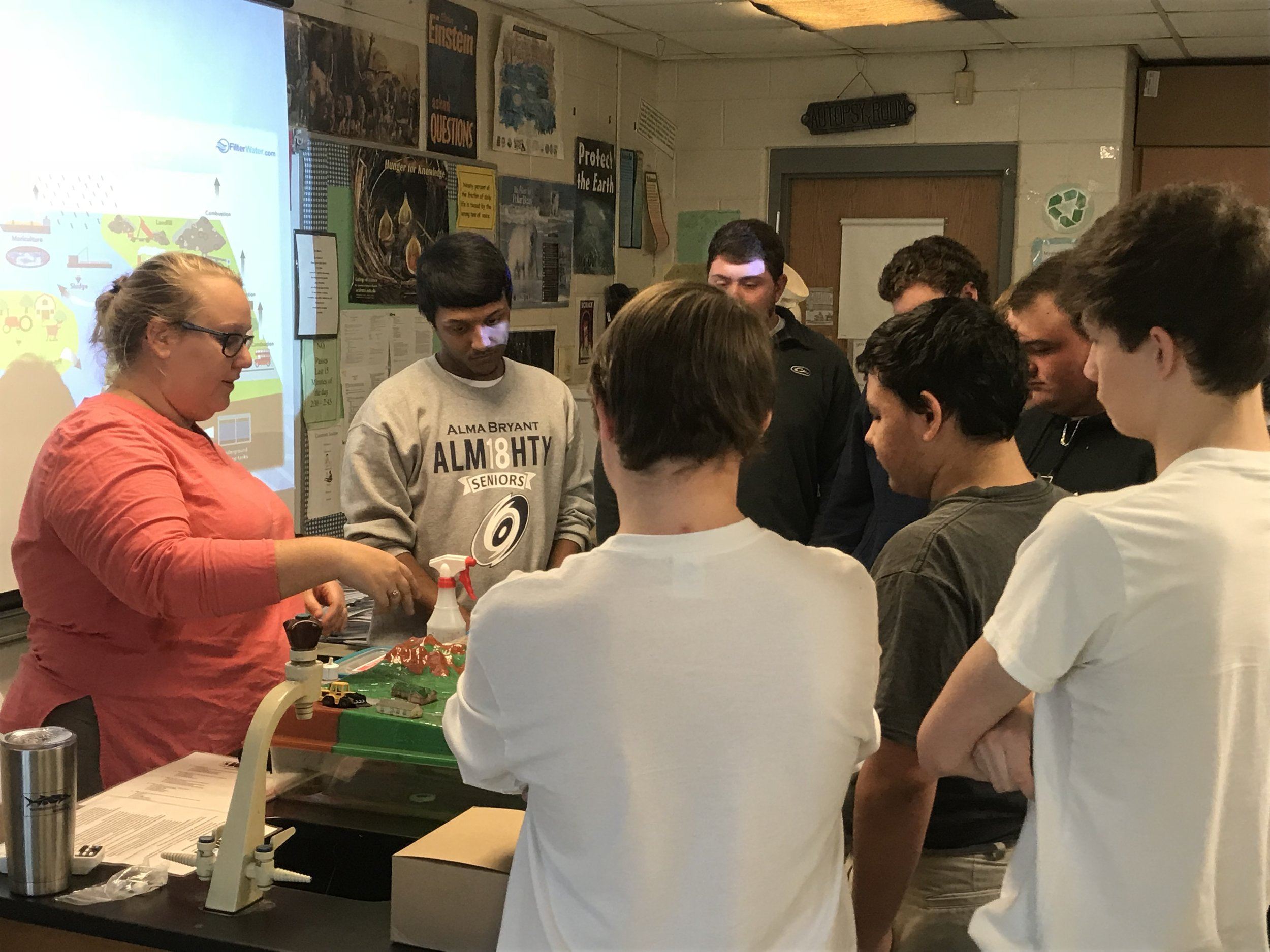 Local students from Alma Bryant High School learn about watersheds through the water table demonstration.