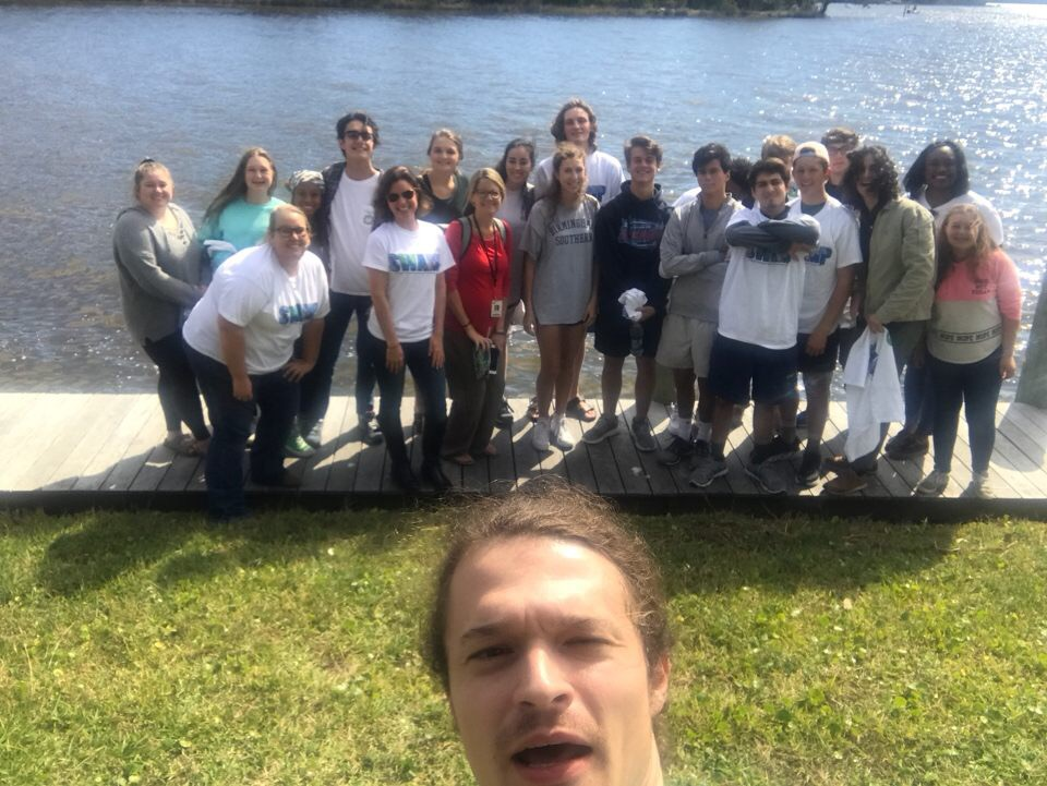 Program Director Cade Kistler takes a selfie with students from Fairhope High School at Weeks Bay Reserve during a water quality monitoring training.