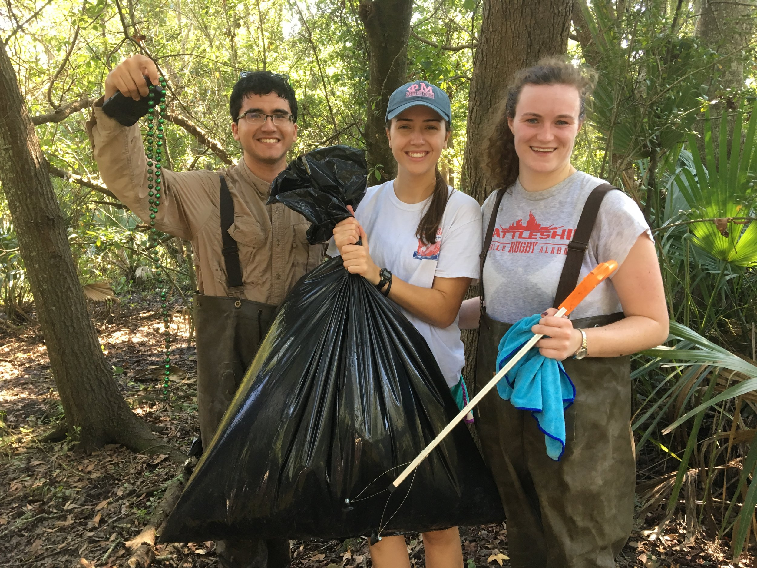 Mobile Baykeeper programs team and interns out collecting litter and assessing One Mile Creek.