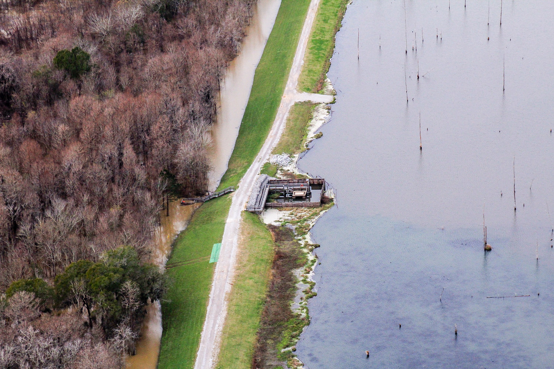Plant Barry's coal ash pond borders the Mobile River in Bucks, AL. Photo: Cade Kistler - Mobile Baykeeper
