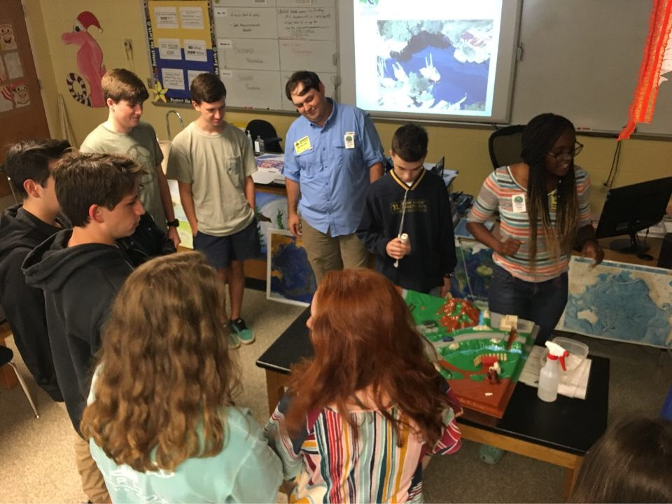Fairhope High School students learn about watersheds through the water table demonstration.
