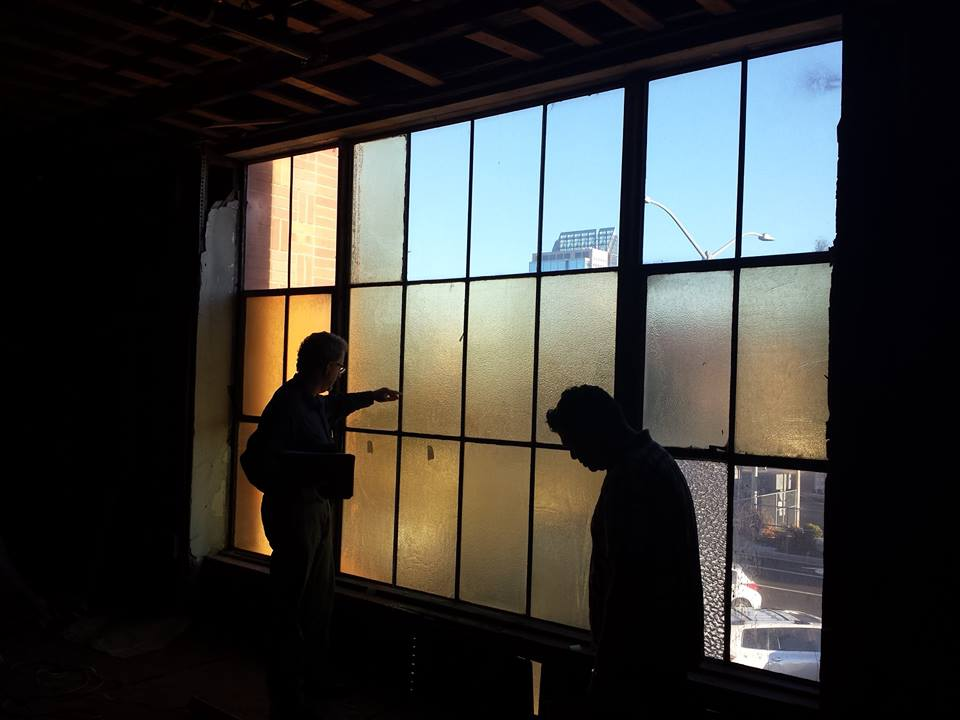 photo:    Preservation Sacramento-  The two windows with tape on them are new windows, test samples installed to compare with the old windows to see which worked best as a replacement for lost panes in the depot's windows.