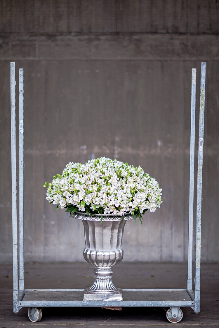 Day 5 of British Flowers Week, featuring an urn bursting with white alstroemeria designed by Rob Van Helden of Rob Van Helden Floral Design, presented to you by New Covent Garden Flower Market