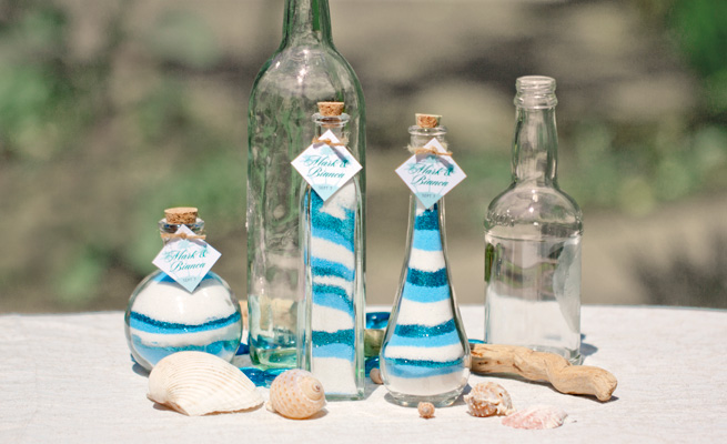 In this figure, dark blue, light blue and white are mixed. You can put them into different bottle shapes or style. These are best for table decoration for an event like beach wedding. It is also perfect for tables in your gardens and inside your home. It's cheaper, natural and more unique than to buy expensive ornament.