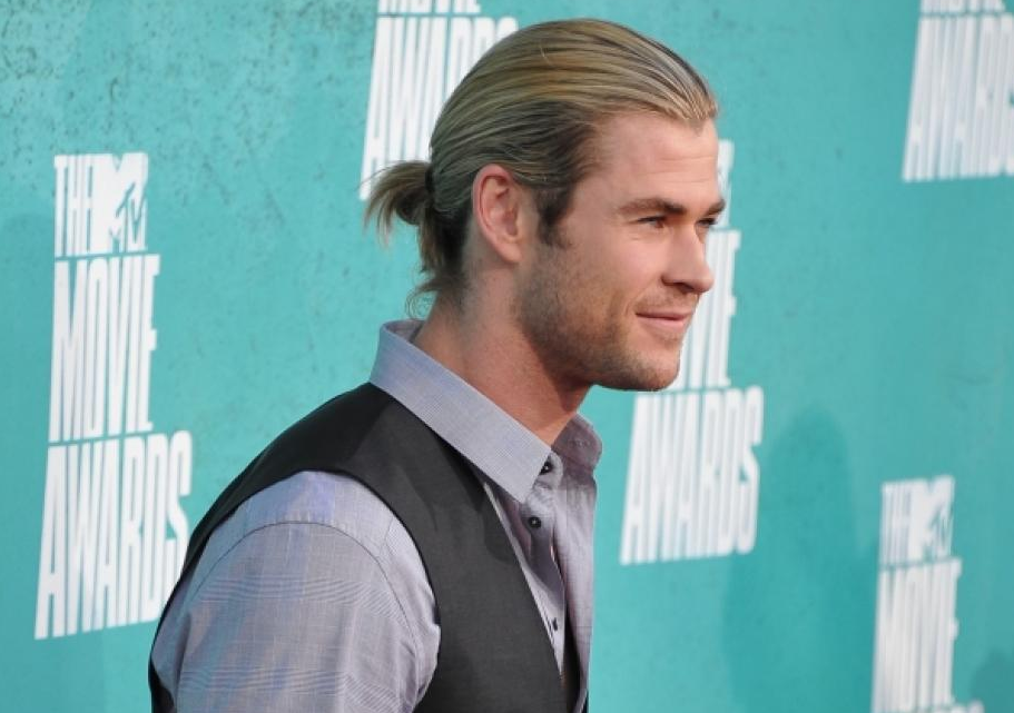 """Thor"" star Chris Hemsworth takes heroic measures to keep his long hair tidy."