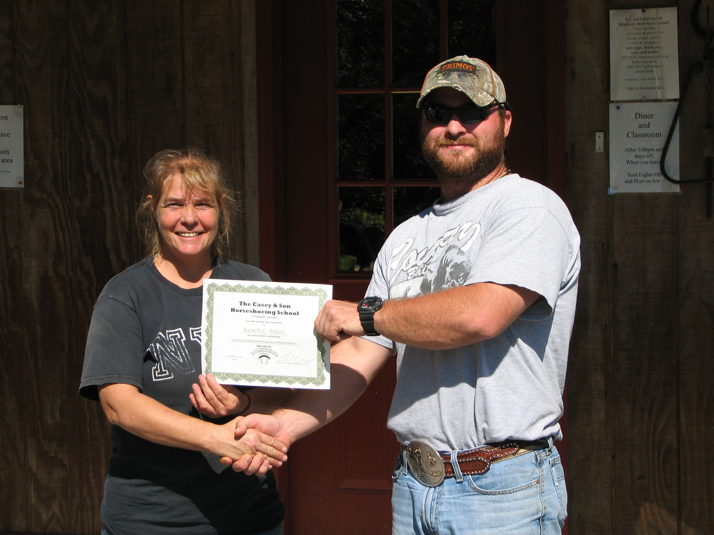 Rachelle Wilcox on graduation day with Link, owner/instructor at Georgia Horseshoeing School 2013