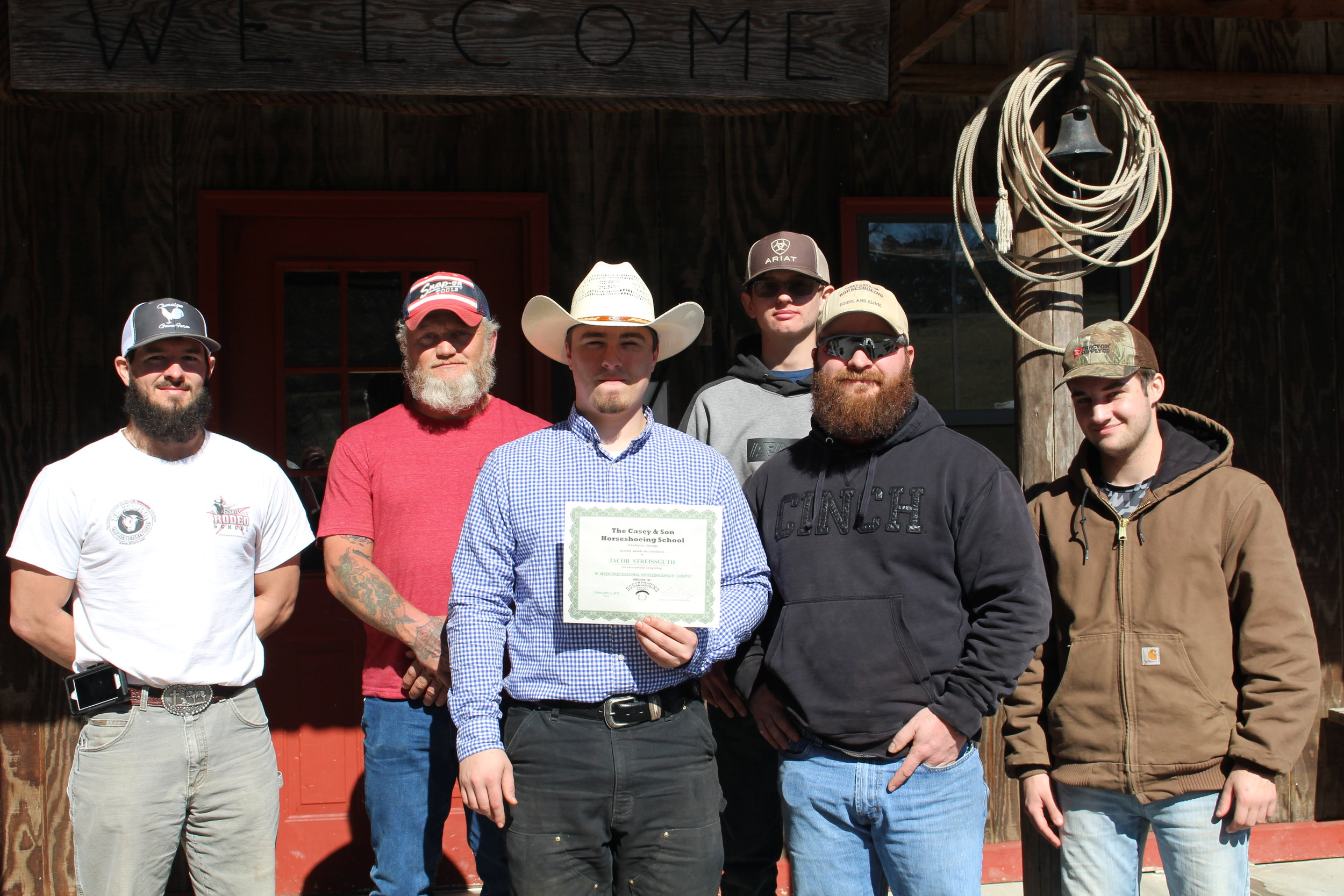 Jacob Streissguth, WA 2.2.2019 farrier graduate with students of Casey Horsehoeing School with Link Casey.JPG
