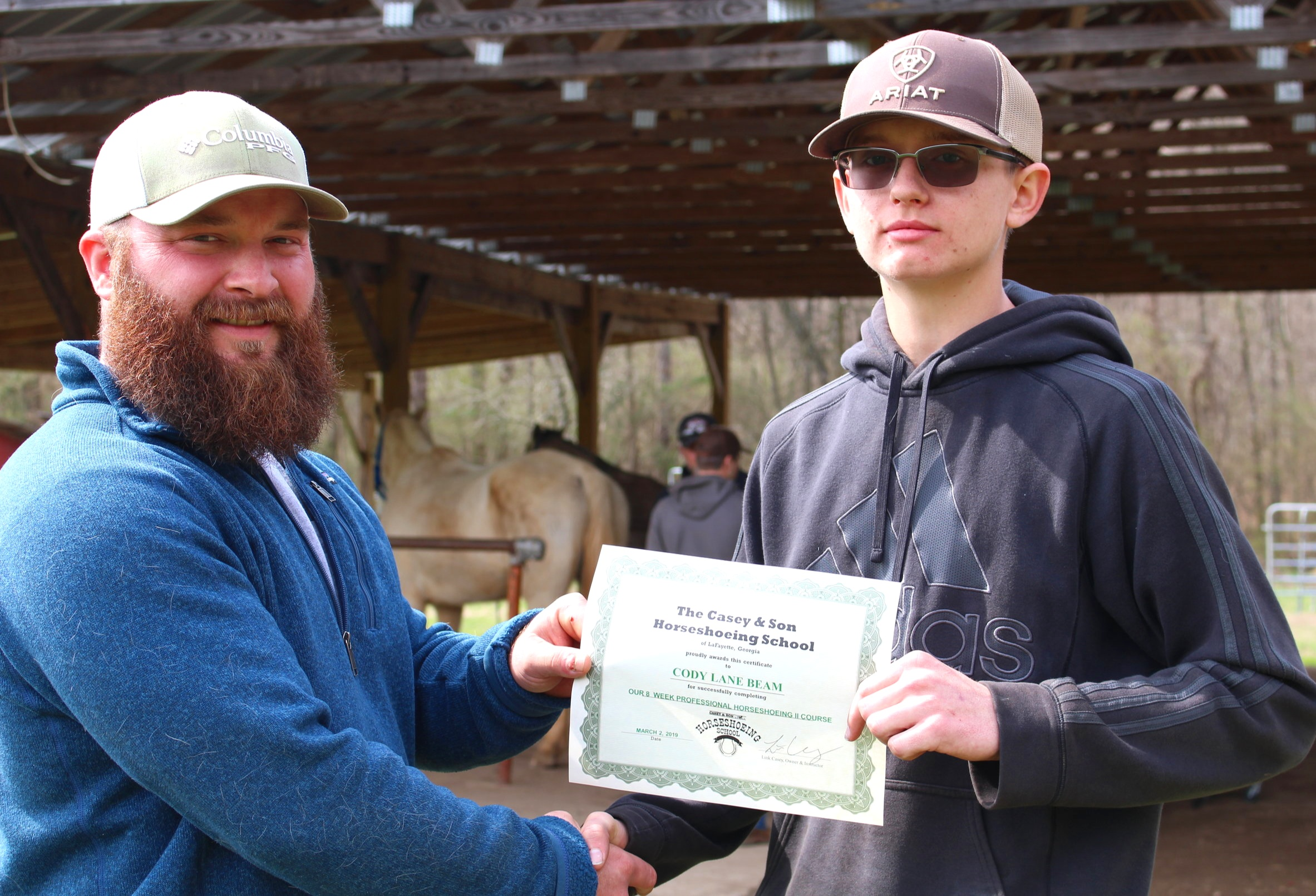 Instructor & Owner Link Casey with Graduate Cody Beam