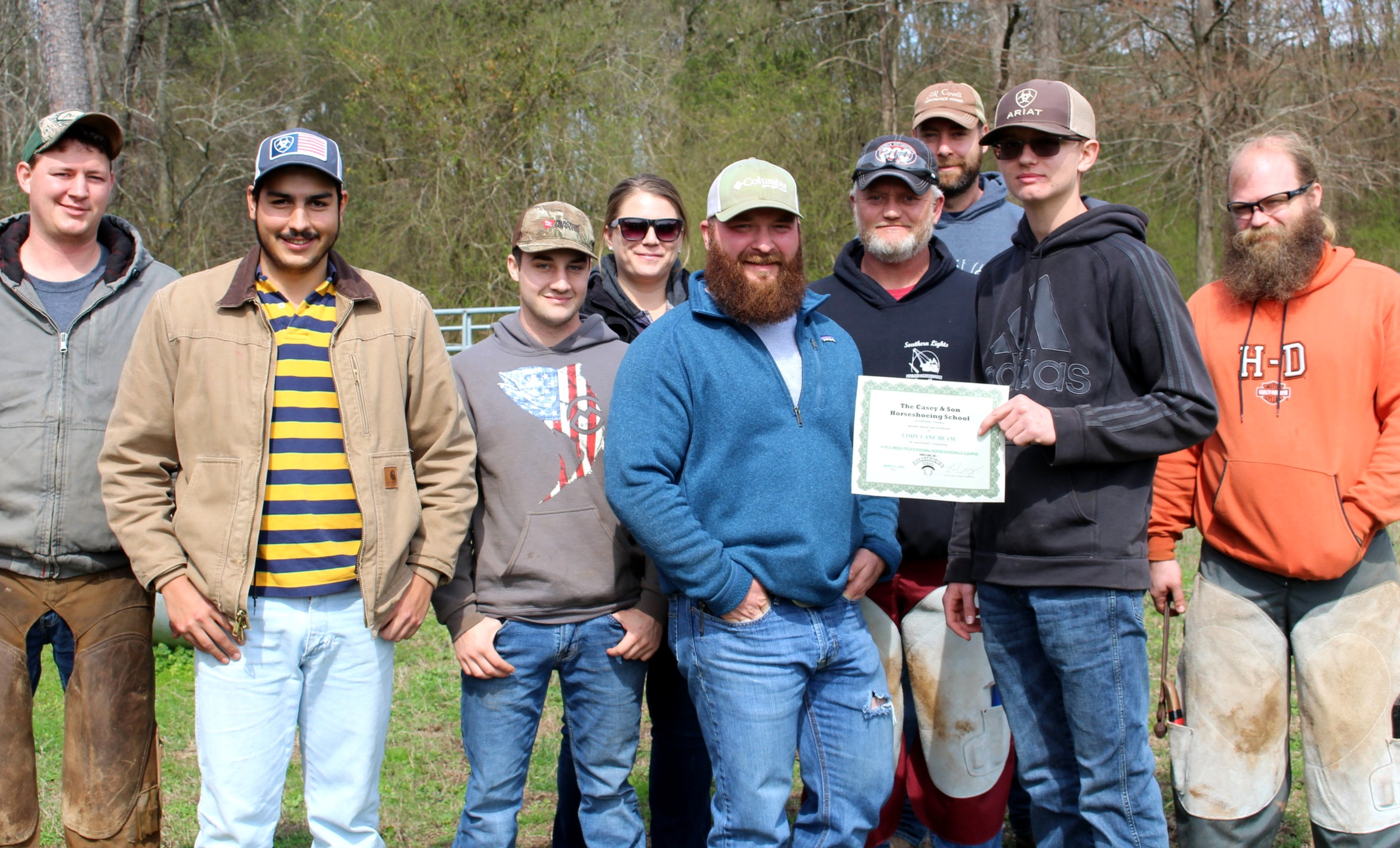 Instructor & Owner Link Casey with Graduate Cody Beam and students.