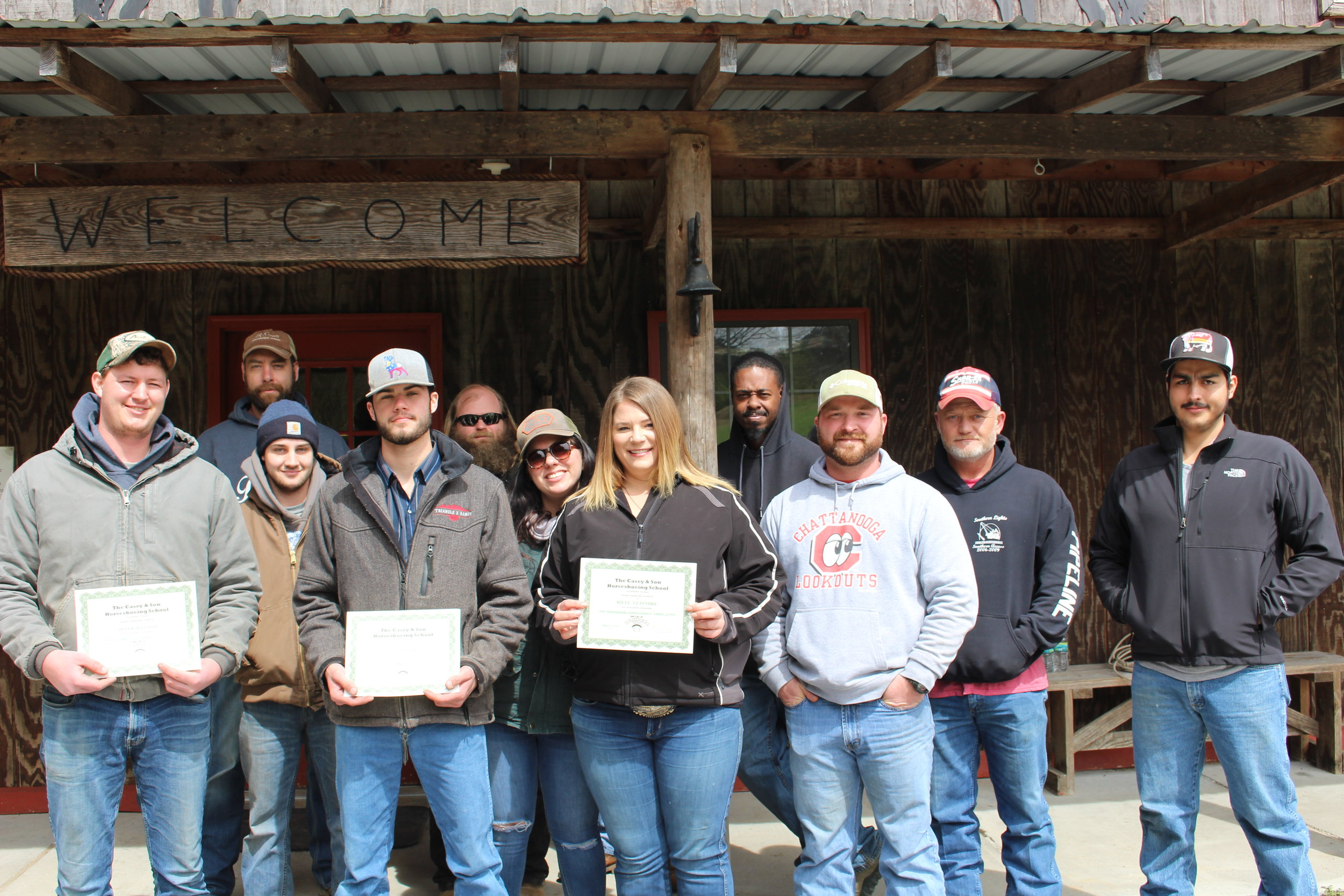 Graduate Farriers from Casey Horseshoeing School, Peter Balogh of MD, Cade Rogers of WY, Rilee Letendre of Canada with Link Casey, Instructor, Owner and current students 3.16.2019.JPG