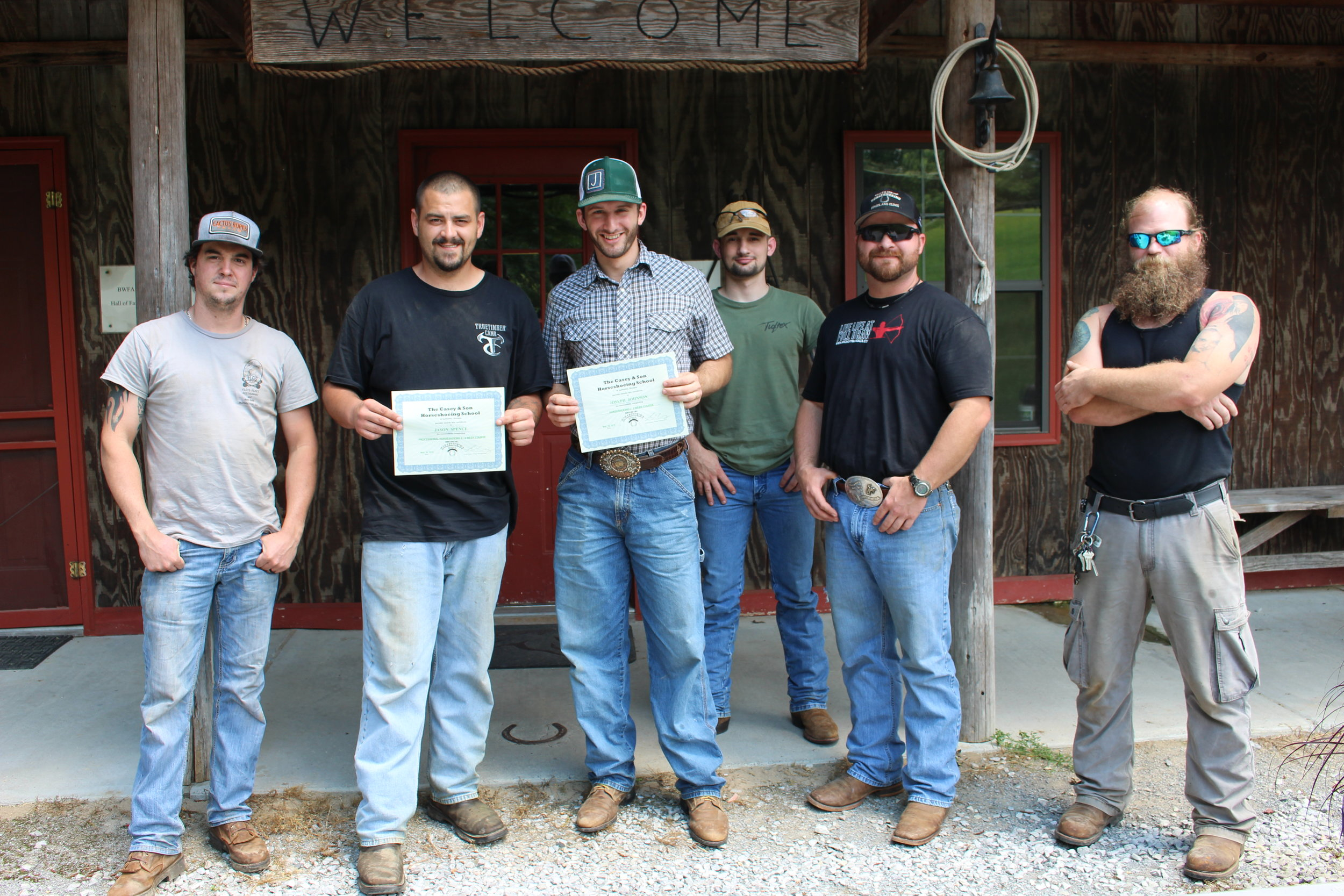 Jason Spence & Joseph Johnson Graduation Photo with future graduates and Link Casey, Owner & Instructor