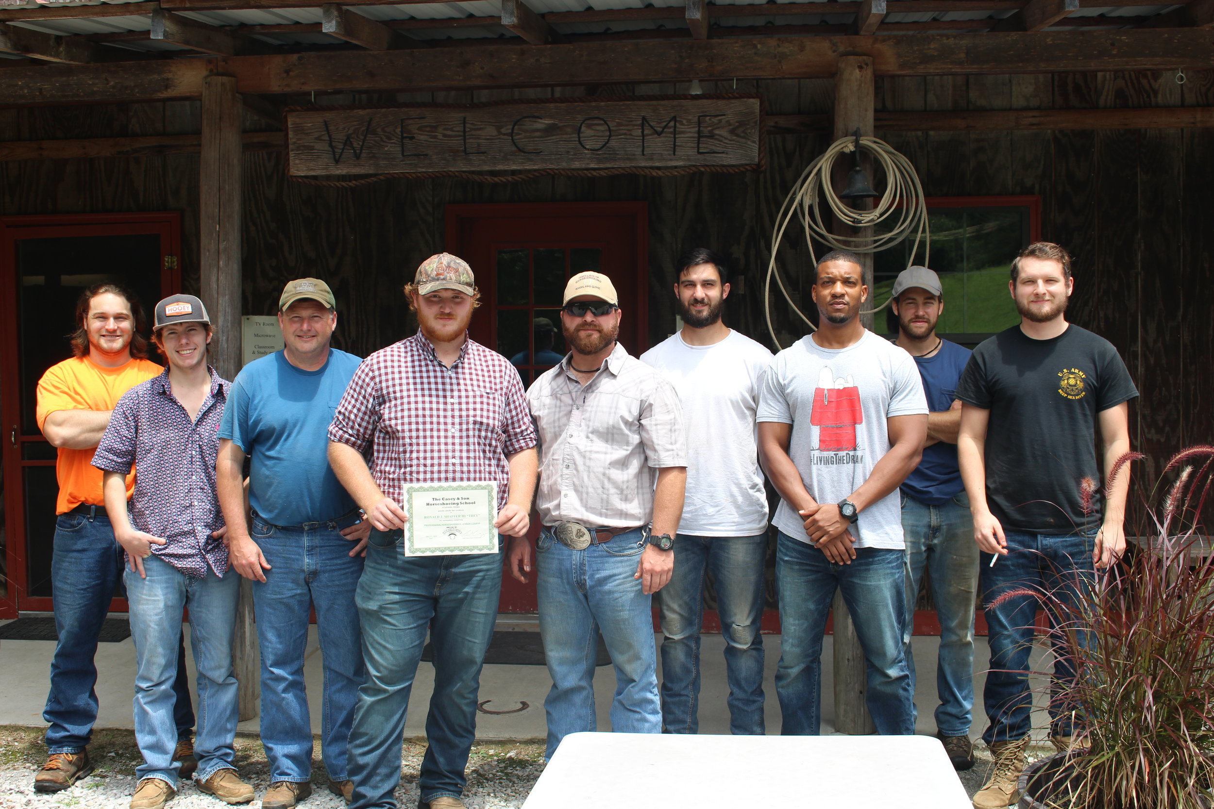 Farrier Graduate of Casey & Son Horseshoeing School Trey Shaffer, with fellow students & Link Casey, owner instructor.